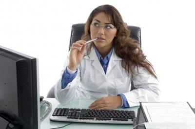 Woman thinking in front of computer