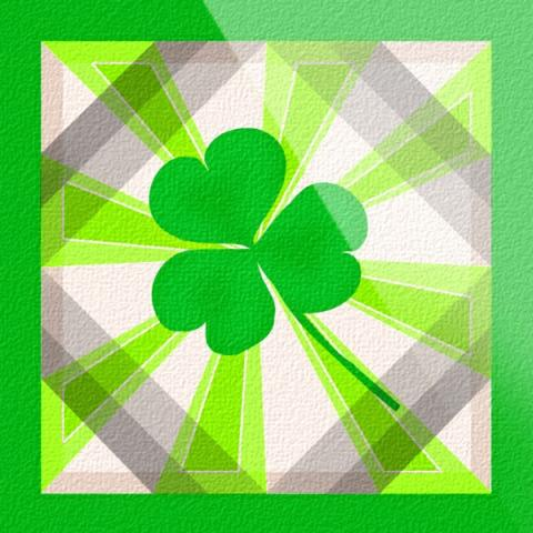 Box outlined with green with green and grey stripes throughout. Green three leaf clover in the center.