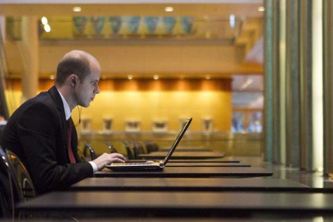 Man at desk using a laptop.