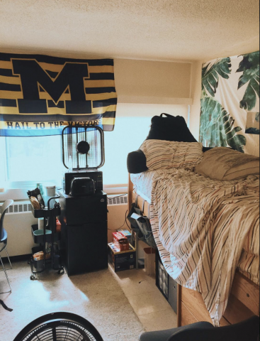 A bedroom with a Michigan flag