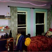 a bedroom with purple walls