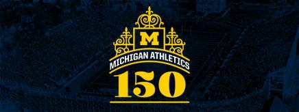 "Michigan Athletics 150th anniversary affinity mark which is a dark navy background with a yellow block M in the middle of a design with ""150"" below the design. All of the font is in yellow."