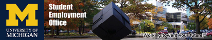 "Picture of the Cube on Campus with fall colored leaves in the background. On the left there is a Block M and it says ""Student Employment Office"" next to it."