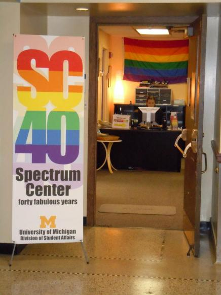 Front door to the Spectrum Center office space with rainbow banner in front of room with SC40 in bold rainbow font