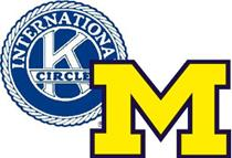 "Circle K logo which is a blue circle that says ""International"" along the top. There is a white K in the middle with ""circle"" written over top of that. Overlapped over the logo is a maize block M with a dark blue outline."