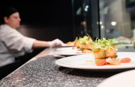A chef plating food