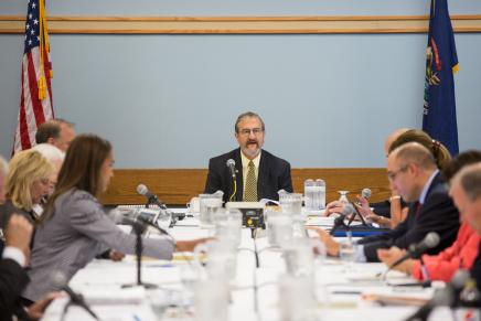 President Schlissel meeting with other people around a table.